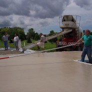 Photo of Workers pouring the Concrete.